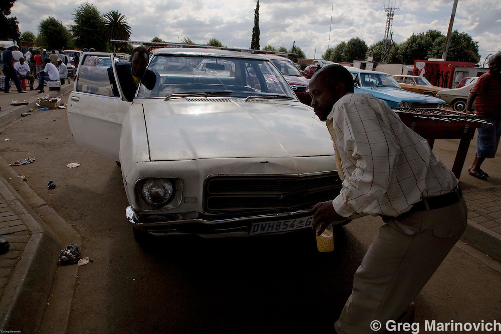 DAVEYTON, SOUTH AFRICA, NOVEMEBR 2008. The Seventies era Chevrolets and Chrysers have been serving Daveyton township as taxis since the late 1970's, when they and Chrusler valiants were the first illegal private taxis for black living in apartheid era dormitory townships. Today, it is only Daveyton that still has the 'cockroaches' and they are being replaced by modern Japanese minibuses. Despite this, there is a love for and a culture around the heavy gas guzzlers. Photo Greg Marinovich