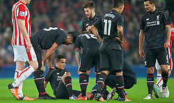 STOKE-ON-TRENT, ENGLAND - Tuesday, January 5, 2016: Liverpool's Philippe Coutinho Correia goes down with a hamstring injury  during the Football League Cup Semi-Final 1st Leg match against Stoke City at the Britannia Stadium. (Pic by David Rawcliffe/Propaganda)