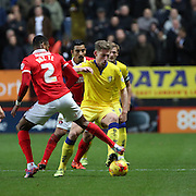 Leeds United defender Charlie Taylor tackling Charlton Athletic striker Ricardo Vaz Te during the Sky Bet Championship match between Charlton Athletic and Leeds United at The Valley, London, England on 12 December 2015. Photo by Matthew Redman.