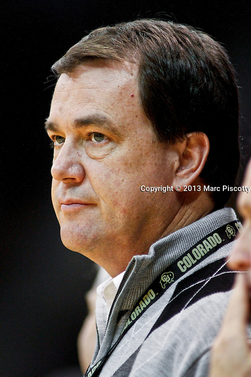 SHOT 3/7/13 7:59:02 PM - University of Colorado athletic director Mike Bohn watches a basketball game against Oregon during their Pac-12 Conference regular season basketball game at the Coors Events Center on the University of Colorado campus in Boulder, Co. Colorado won the game 76-53..(Photo by Marc Piscotty / © 2013)