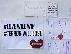 © Licensed to London News Pictures. 20/06/2017. London, UK. Messages of solidarity and support adorn a wall in Whadcoat Street in Finsbury Park in north London where a van ploughed into a crowd near Finsbury Park Mosque.  One person has been killed and 10 people are injured. Darren Osborne, 47, from Cardiff, continues to be held on suspicion of attempted murder and alleged terror offences.  Photo credit: Peter Macdiarmid/LNP
