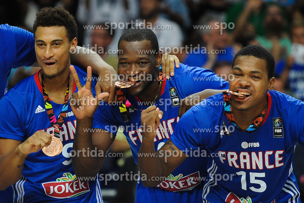 Edwin Jackson, Charles Kahudi, Mickael Gelabale of France celebrate after winning bronze medal during the 2014 FIBA World Basketball Championship Third Place match between France and Lithuania at the Palacio de los Deportes, on September 13, 2014 in Madrid, Spain. Photo by Tom Luksys  / Sportida.com <br /> ONLY FOR Slovenia, France