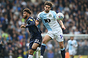 Leeds United forward Tyler Roberts (11) and Blackburn Rovers defender Charlie Mulgrew (14)  during the EFL Sky Bet Championship match between Blackburn Rovers and Leeds United at Ewood Park, Blackburn, England on 20 October 2018.