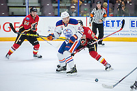 PENTICTON, CANADA - SEPTEMBER 17:  Tyler Vesel #46 of the Edmonton Oilers passes the puck against the Calgary Flames on September 17, 2016 at the South Okanagan Event Centre in Penticton, British Columbia, Canada.  (Photo by Marissa Baecker/Shoot the Breeze)  *** Local Caption *** Tyler Vesel;