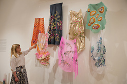 © London News Pictures. 23/06/15. London, UK. Bethany Bull looks at some textiles which art part of the Royal College of Art Graduate Exhibition 2015, Central London. Photo credit: Laura Lean/LNP