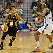 Angel Goodrich, (left), Tulsa Shock, drives past Renee Montgomery, Connecticut Sun, during the Connecticut Sun Vs Tulsa Shock WNBA regular season game at Mohegan Sun Arena, Uncasville, Connecticut, USA. 3rd July 2014. Photo Tim Clayton
