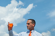 Somerville Mayor Joe Curtatone raises a cup of orange soda in honor the the ribbon cutting for new Assembly Row T station during a reception before the ribbon cutting; September 2, 2014. (Wicked Local Staff Photo/ Sam Goresh)
