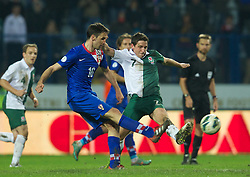 OSIJEK, CROATIA - Tuesday, October 16, 2012: Wales' Joe Allen in action against Croatia's Milan Badelj during the Brazil 2014 FIFA World Cup Qualifying Group A match at the Stadion Gradski Vrt. (Pic by David Rawcliffe/Propaganda)