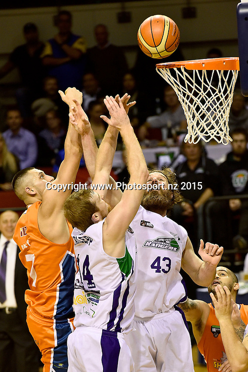 Duane Bailey (L) of the Southland Sharks takes a shot at the hoop with Casey Frank (R and Tom Garlepp of the Super City Rangers during the NBL semi final basketball match between Southland and Super City Rangers at the TSB Arena in Wellington on Saturday the 4th of July 2015. Copyright photo by Marty Melville / www.Photosport.nz