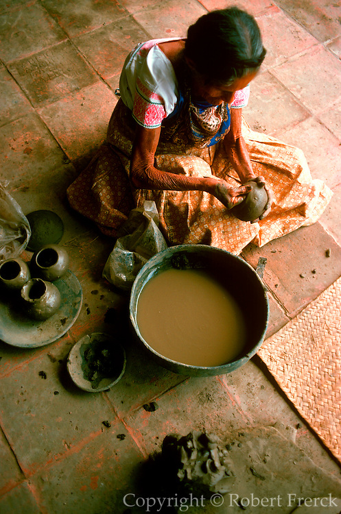 MEXICO, CRAFTS Dona Rosa making her famous black, ceramic pottery in the village of San Bartolo Coyotepec near Oaxaca