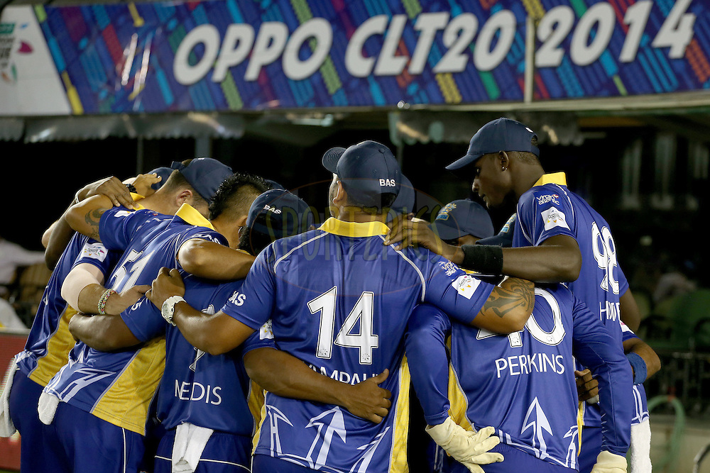 Barbados Tridents team in the huddle before the start of match 5 of the Oppo Champions League Twenty20 between the Kings XI Punjab and the Barbados Tridents held at the Punjab Cricket Association Stadium, Mohali, India on the 20th September 2014. Photo by:  Jacques Rossouw / Sportzpics/ CLT20<br /> <br /> <br /> Image use is subject to the terms and conditions as laid out by the BCCI/ CLT20.  The terms and conditions can be downloaded here:<br /> <br /> http://sportzpics.photoshelter.com/gallery/CLT20-Image-Terms-and-Conditions-2014/G0000IfNJn535VPU/C0000QhhKadWcjYs