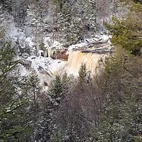 Icy Blackwater Falls runs fast after snow melt. Blackwater Falls State Park, Davis, West Virginia.