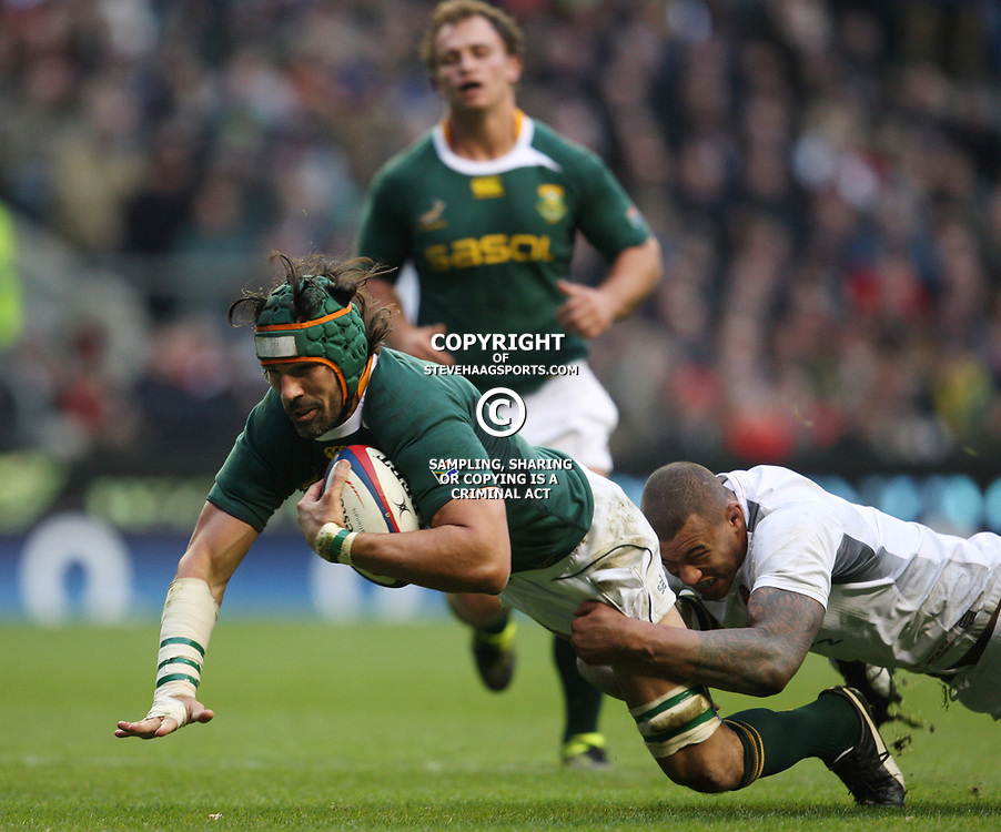LONDON, ENGLAND - NOVEMBER 27, Victor Matfield (capt) is tackled just short of the line by Courtney Lawes during the End of Year tour match between England and South Africa at Twickenham Stadium on November 27, 2010 in London, England<br /> Photo by Steve Haag / Gallo Images