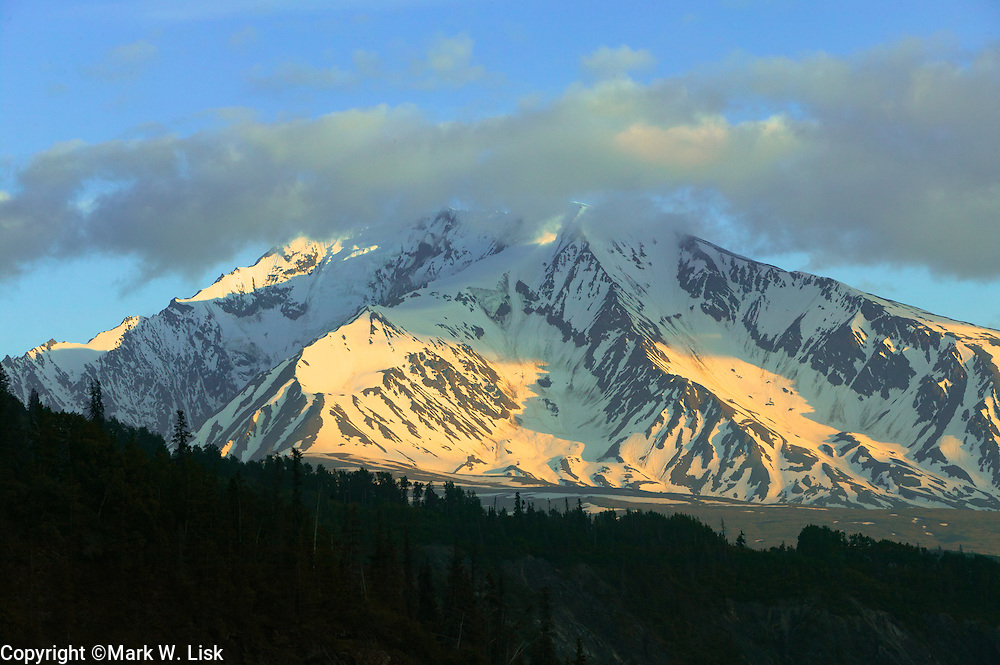 Snow clad peaks in the Alsek range stand in cloud cover in the Tatshenshini river coridor, Canada.