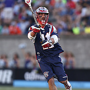 Matt Smalley #11 of the Boston Cannons throws the ball during the game at Harvard Stadium on May 17, 2014 in Boston, Massachuttes. (Photo by Elan Kawesch)