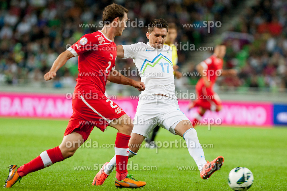 Stephan Lichtsteiner of Sweitterland and Andraz Kirm of Slovenia during qualifications football match for world cup 2014 in Brazil between national team of Slovenia and Switzerland, on September 7, 2012 in Ljubljana, Slovenia. (Photo by Urban Urbanc / Sportida.com)