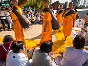 "02 JANUARY 2015 - KHLONG LUANG, PATHUM THANI, THAILAND: Monks walk through the crowd at Wat Phra Dhammakaya on the first day of the 4th annual Dhammachai Dhutanaga (a dhutanga is a ""wandering"" and translated as pilgrimage). More than 1,100 monks are participating in a 450 kilometer (280 miles) long pilgrimage, which is going through six provinces in central Thailand. The purpose of the pilgrimage is to pay homage to the Buddha, preserve Buddhist culture, welcome the new year, and ""develop virtuous Buddhist youth leaders."" Wat Phra Dhammakaya is the largest Buddhist temple in Thailand and the center of the Dhammakaya movement, a Buddhist sect founded in the 1970s.   PHOTO BY JACK KURTZ"