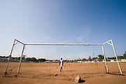 Boy standing in football goal in Accra, Ghana, 2006.