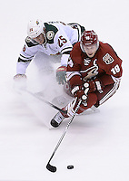Dec 13, 2014; Glendale, AZ, USA; Arizona Coyotes forward Shane Doan (19) handles the puck against Minnesota Wild defensemen Jonas Brodin (25) during overtime of the NHL game at Gila River Arena. The Wild's won 4-3 in a shootout. Mandatory Credit: Jennifer Stewart-USA TODAY Sports