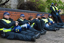 London, August 31st 2015. Territoriasl Support Group officers from the Met Police rest up as revellers ignore the inclement weather to enjoy day two of the Notting Hill Carnival.