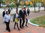 President Barack Obama walks to St. John's Episcopal Church with his daughters on October 28, 2012  left to right:  Kaye Wilson,Godmother to Malia and Sasha,   Sasha Obama, President Obama, Malia Obama. photo by Dennis Brack...