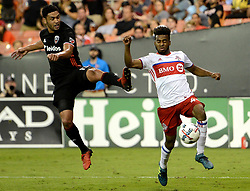 August 5, 2017 - Washington, DC, USA - 20170805 - D.C. United midfielder LAMAR NEAGLE (13) tries to intercepts a long pass to Toronto FC midfielder RAHEEM EDWARDS (44) in the second half at RFK Stadium in Washington. (Credit Image: © Chuck Myers via ZUMA Wire)