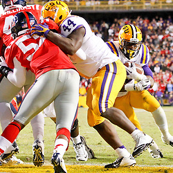 November 17, 2012; Baton Rouge, LA, USA;  LSU Tigers running back Jeremy Hill (33) runs for a touchdown in the fourth quarter against the Ole Miss Rebels in a game at Tiger Stadium. LSU defeated Ole Miss 41-35. Mandatory Credit: Derick E. Hingle-US PRESSWIRE