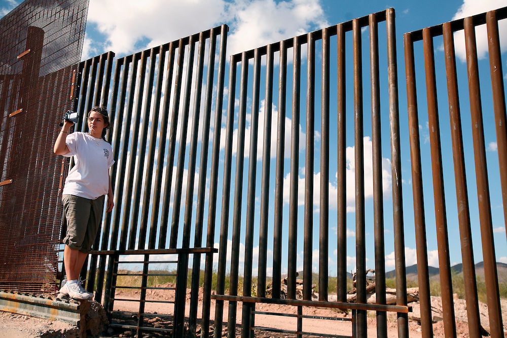 In the desert of Mexico, a foreign exchange student  from Australia takes video at the border fence built on the Mexico/US boundary near Agua Prieta Mexico and Douglas, Arizona. The newly built fence is part of the project to secure the nearly 2,000 mile border - which is widely considered the most frequently traveled international border in the world, with an estimated 250 legal and 500 million illegal crossings every year. She did not attempt to cross.