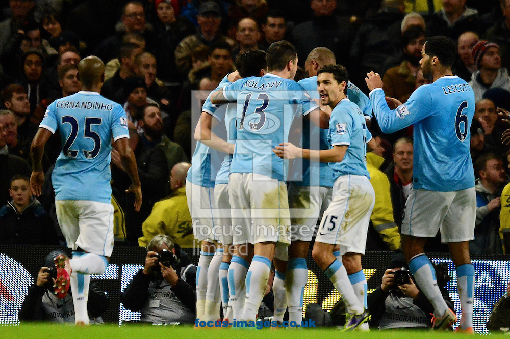 Picture by Ian Wadkins/Focus Images Ltd +44 7877 568959<br /> 26/12/2013<br /> Manchester City players celebrate after scoring to make it 1-1 during the Barclays Premier League match at the Etihad Stadium, Manchester.