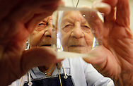 "CAPTION: (New Port Richey 01/23/2008) (photo#1) John ""The Greek"" Proies, 90, is reflected in a prism at his work station at VLOC, a company that manufactures precision optics and crystals.  SUMMARY: John Proies is a master optician at VLOC, the laser industry company in Trinity. He happens to have just turned 90 years old. BRENDAN FITTERER 