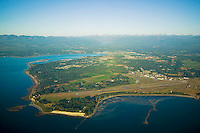 An aerial view of the Comox Peninsula, including CFB Comox and Kye Bay on the eastern shores of Vancouver Island.  Comox, Vancouver Island, British Columbia, Canada.