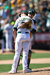 OAKLAND, CA - JUNE 21:  Tyler Clippard #36 of the Oakland Athletics hugs Stephen Vogt #21 after the game against the Los Angeles Angels of Anaheim at O.co Coliseum on June 21, 2015 in Oakland, California. The Oakland Athletics defeated the Los Angeles Angels of Anaheim 3-2. (Photo by Jason O. Watson/Getty Images) *** Local Caption *** Tyler Clippard; Stephen Vogt