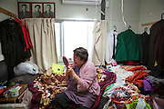 Tsuyako Taira, 80 years old, is sitting on her bed in a tiny room in her temporary housing apartment in Ishinomaki. She is sharing the apartment with her 56-year old son. They lost everything in the tsunami March 11, 2011.