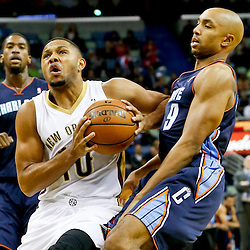 Nov 2, 2013; New Orleans, LA, USA; New Orleans Pelicans shooting guard Eric Gordon (10) drives past Charlotte Bobcats shooting guard Gerald Henderson (9) during the first half of a game at New Orleans Arena. Mandatory Credit: Derick E. Hingle-USA TODAY Sports