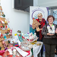 Mary O'Sullivan and Karolana Sokulska, Volunteers with Haven Horizons, wIth the Skills programme holding some upcycled Christmas decorations