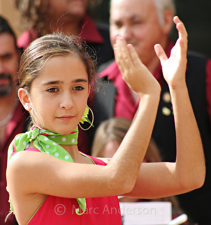 A girl dancing to traditional Spanish Flamenco music in Andalucia, Spain.