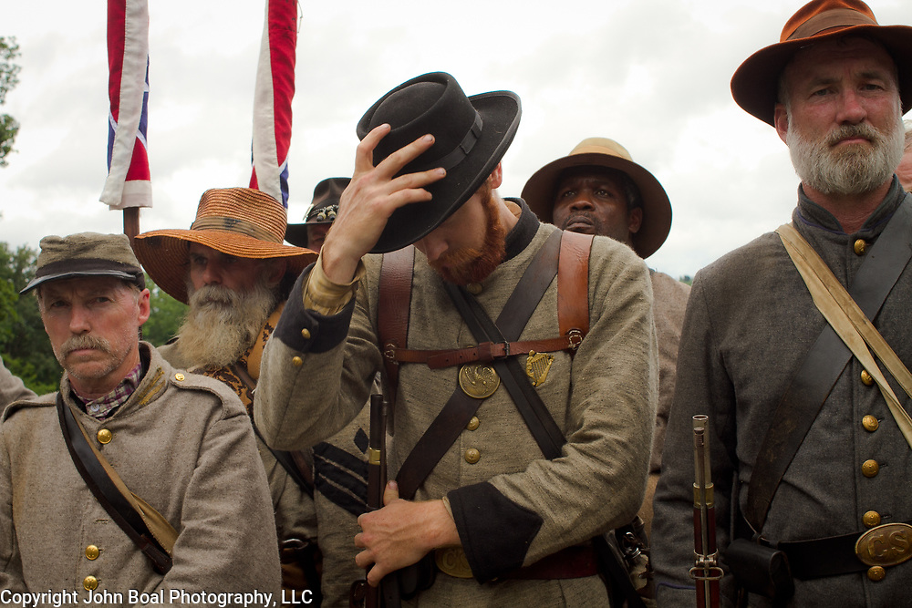 """Michael Jantzen, of Freeport, Michigan, replaces his hat, following a moment in in which he paid his respects to the Robert E. Lee statue at the Virginia Memorial during the Sesquicentennial Anniversary of the Battle of Gettysburg, Pennsylvania on Wednesday, July 3, 2013.  Jantzen regarded Lee and Stonewall Jackson as heroes """"...not for their ability on the battlefield, but for the lives they led as good Christian men...""""  The Battle of Gettysburg lasted from July 1-3, 1863 resulting in over 50,000 soldiers killed, wounded or missing.  John Boal Photography"""