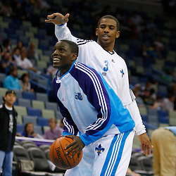 Mar 31, 2010; New Orleans, LA, USA; New Orleans Hornets guard Chris Paul (back) works against guard Darren Collison (front) during warm ups prior to tip off against the Washington Wizards at the New Orleans Arena. Mandatory Credit: Derick E. Hingle-US PRESSWIRE