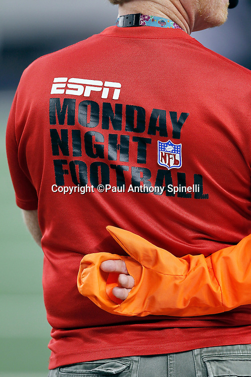 A time keeper sports an ESPN Monday Night Football shirt at the Dallas Cowboys NFL week 7 football game against the New York Giants on Monday, October 25, 2010 in Arlington, Texas. The Giants won the game 41-35. (©Paul Anthony Spinelli)