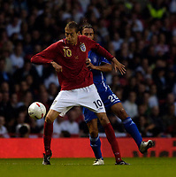 Photo: Jed Wee.<br /> England v Greece. International Friendly. 16/08/2006.<br /> <br /> England's Peter Crouch (L) holds off Greece's Papaskevas Antzas.