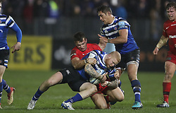 Bath's Tom Homer is tackled by Saracens Alex Lewington during the Gallagher Premiership match at the Recreation Ground, Bath.