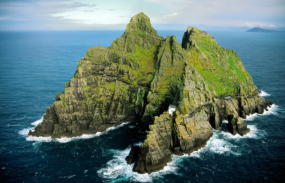 Skellig Michael, Kerry, Ireland.  Celtic Monastic settlement on right side summit. New lighthouse centre. Old lighthouse left.