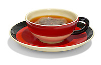 redbush tea in a red and black cup and saucer