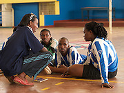 Olive Akobasenga (front left) is a sprinter and the first female to compete for Rwanda in the Paralympics. When she is not training or competing Olives likes to encourage other women to get involved in sport.