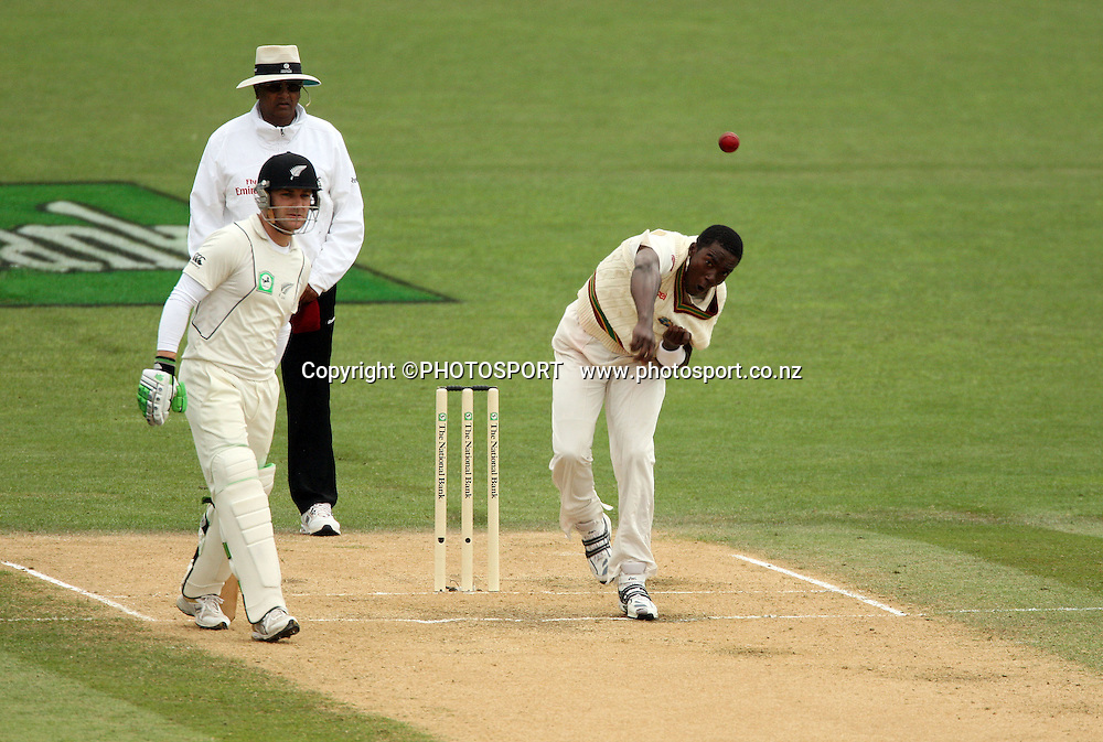 Jerome Taylor in action bowling as Brendon McCullum looks on during play on day 3 of the second cricket test at McLean Park in Napier. National Bank Test Series, New Zealand v West Indies, Sunday 21 December 2008. Photo: Andrew Cornaga/PHOTOSPORT