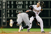 May 7, 2012; Houston, TX, USA; Houston Astros shortstop Jed Lowrie (4) tags out Miami Marlins shortstop Jose Reyes (7) during a steal attempt during the first inning at Minute Maid Park. Mandatory Credit: Thomas Campbell-US PRESSWIRE