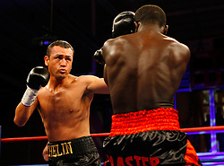 April 3, 2008; Brooklyn, NY, USA;  Joshua Clottey and Jose Luis Cruz-Felix trade punches during their welterweight bout at the Aviator Sports and Recreation Complex in Brooklyn, NY.