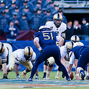 Army Quarterback Trent Steelman #8 lines up his offense while Navy Linebacker Matt Warrick #51watches in the second quarter of the 112th version of this storied rivalry Saturday, Dec. 10, 2011 at Fed EX field in Landover Md. ..Navy set the tone early in the game as Navy defeats Army 31-17 in front of 82,000 at Fed EX Field in Landover Md
