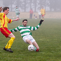 Rhine Rover's Jamie Ivers slides in for the ball along with Avenue A's David Herlihy