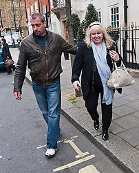 © London News Pictures. 16/04/2012. London, UK.  Dwina Gibb (right), the wife of singer Robin Gibb of the Bee Gees musical group being escorted from The London Clinic in central London on April 16, 2012. Robin Gibb, singer with the legendary British band the Bee Gees, is in a coma in hospital  after contracting pneumonia in his battle against cancer. Photo credit :  Ben Cawthra/LNP